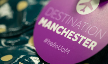 Luggage label reading 'Destination Manchester'