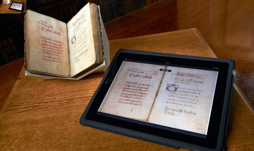 Book from special collections alongside a tablet device