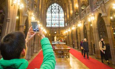 a visitor taking a photo