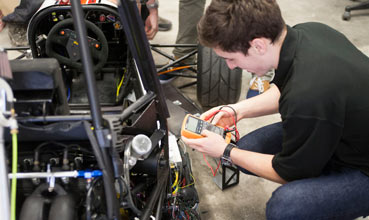 Student working on a vehicle prototype