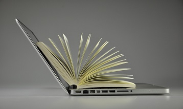 picture of open laptop and book inside