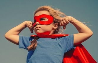 Picture of child dressed as a masked heroine